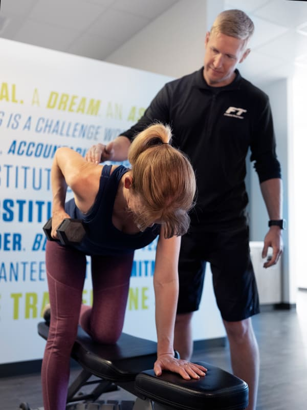 Trainer working with Fitness Together client